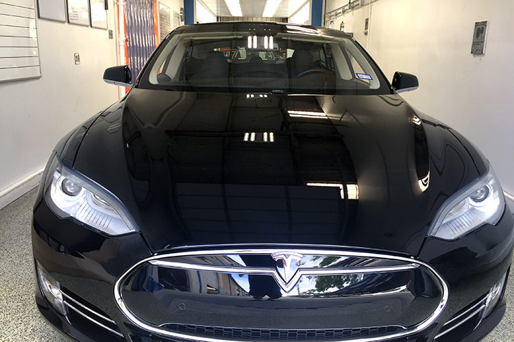 Front end of a Tesla vehicle repaired from an auto accident
