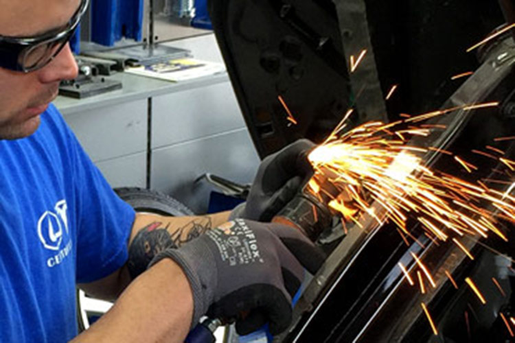 Welding automotive repair at Autocraft Bodywerks in Austin, Texas