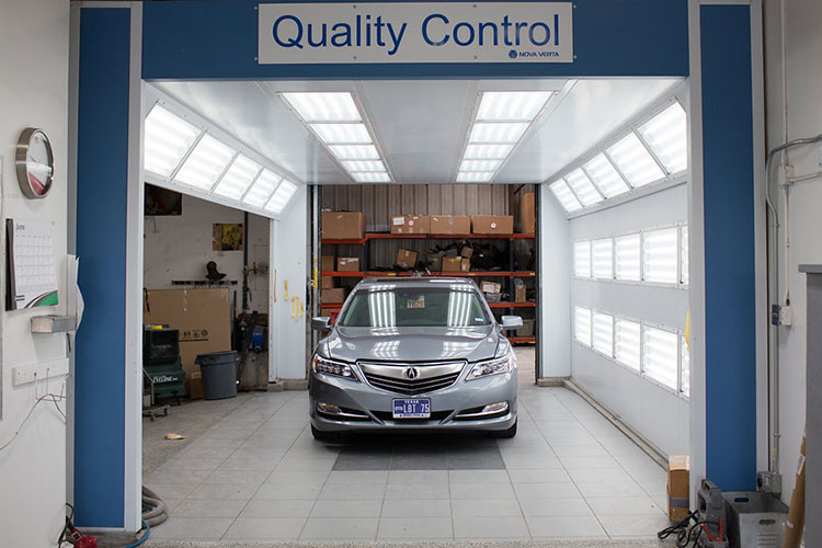 Acura going through quality control as last stage of automotive repair process